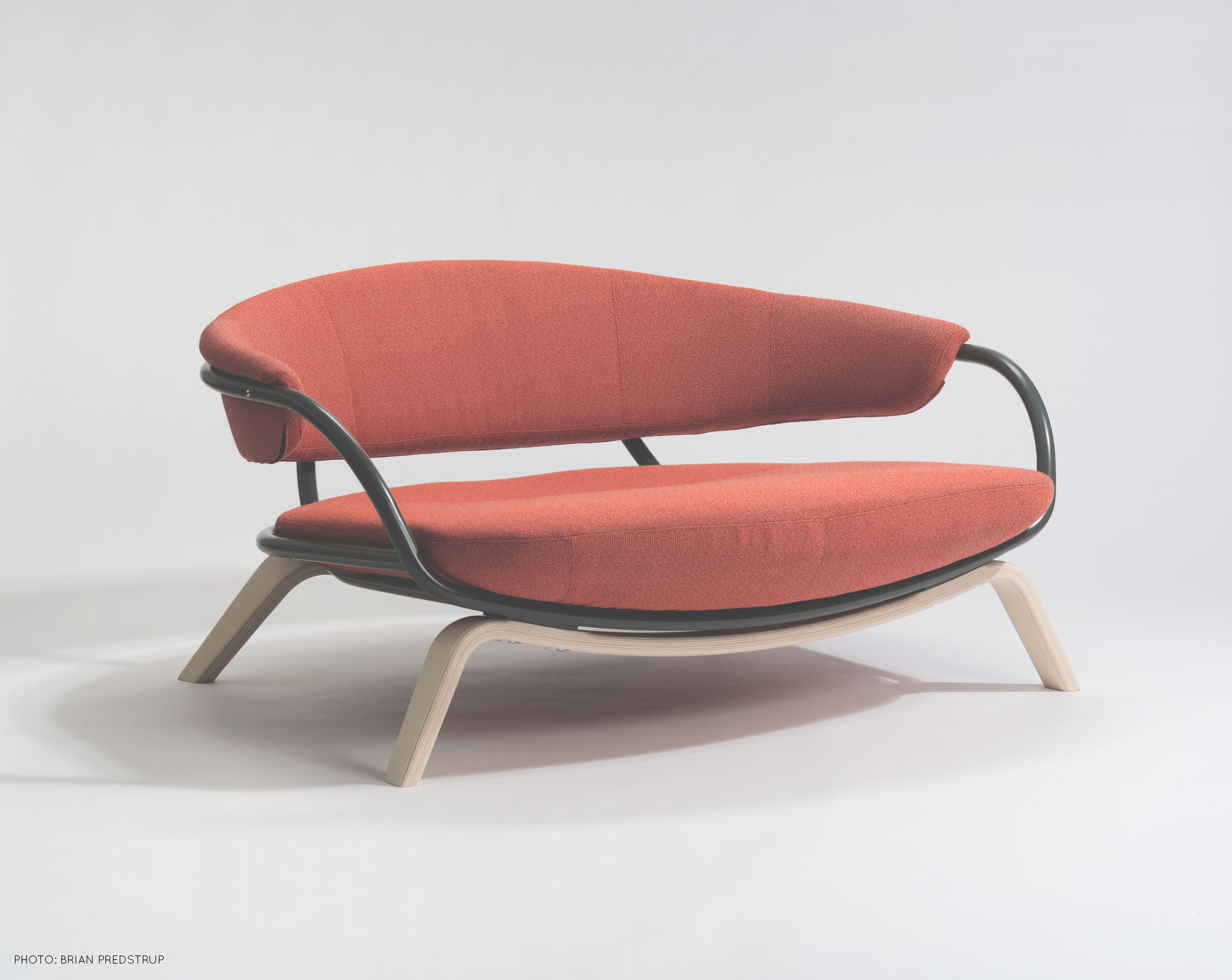 Orange armchair for two persons, inspired by Ingmar Bergman and built in Småland, by Sebastian Galo