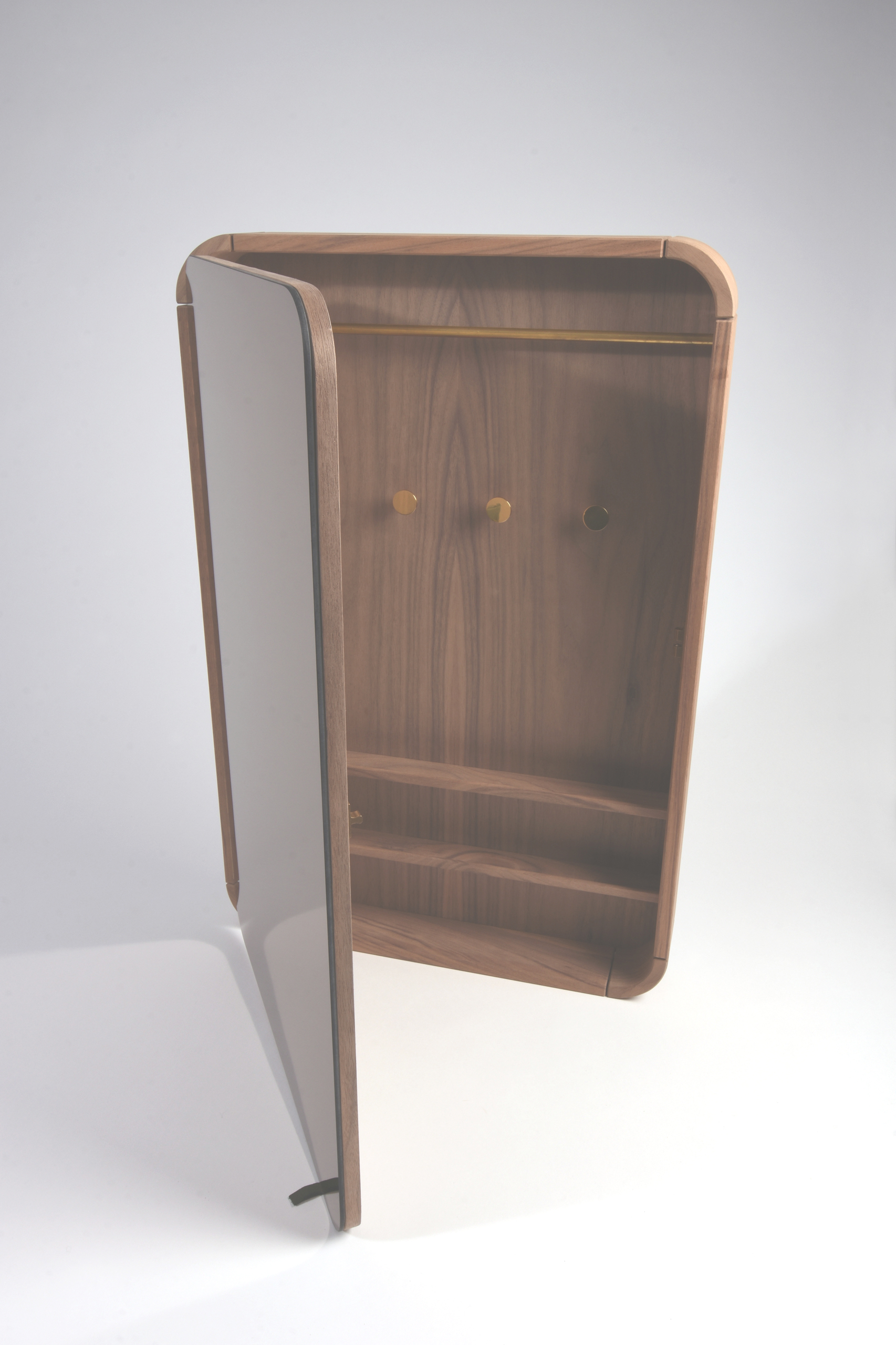 Combination furniture in walnut and brass with mirror, by Sebastian Galo